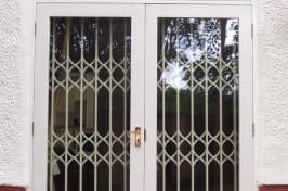 white retractable security grilles