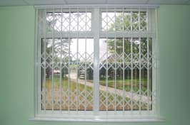 retractable security grilles in window
