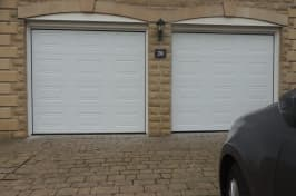 two white sectional garage doors